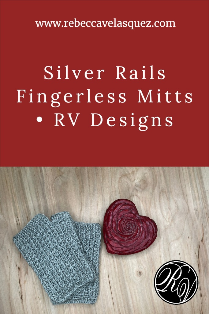 Fingerless Mitts next to heart paperweight