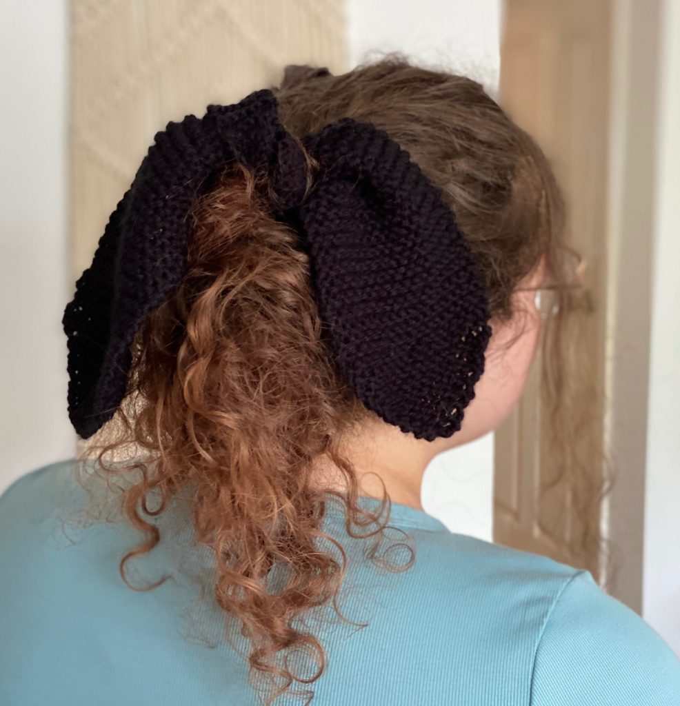 Lady with black knit hair tie