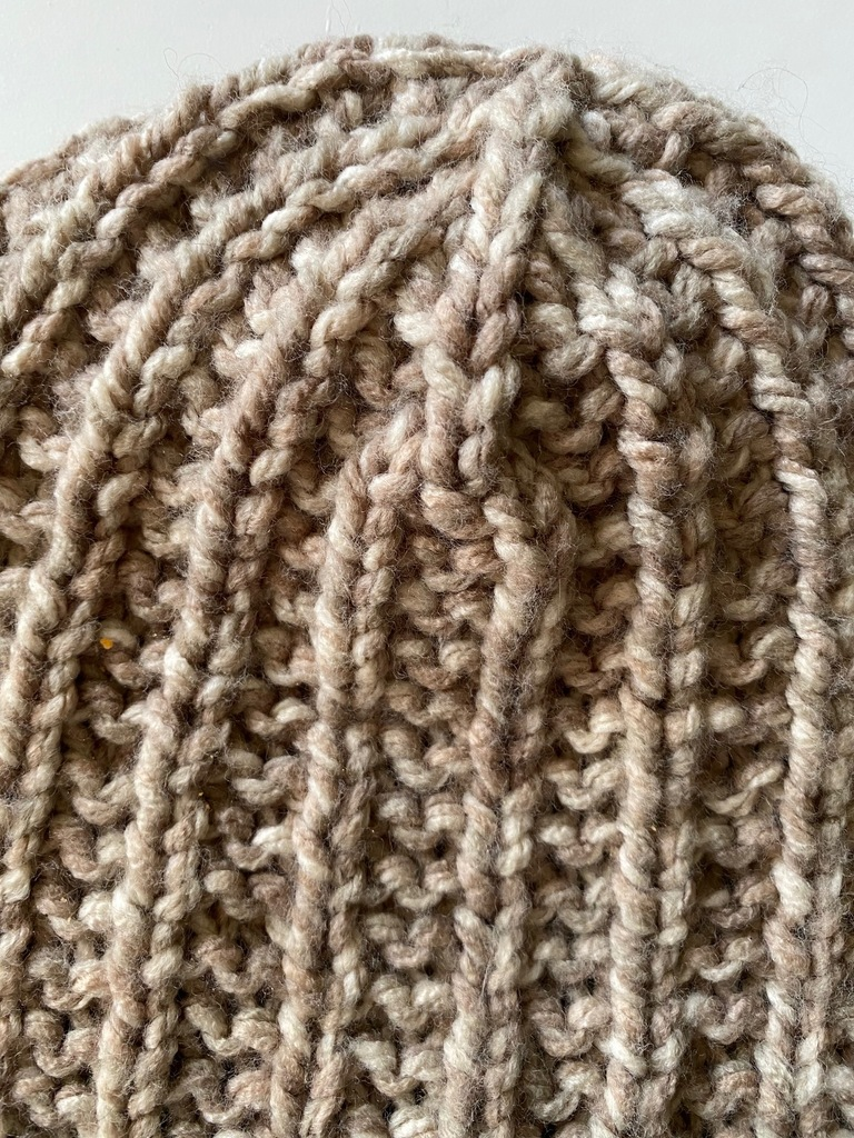 close up view of carten knit hat pattern