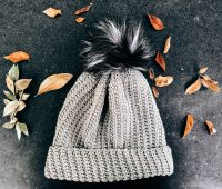 Crochet hat with fuzzy ball on top, Jessie Slouch