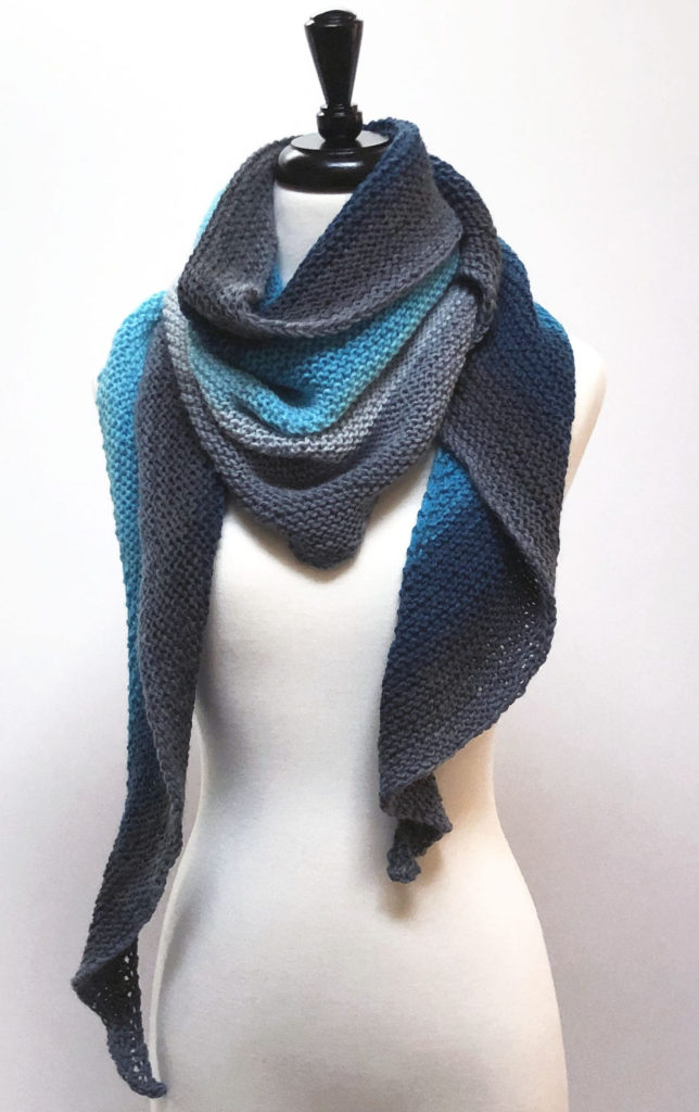 Blue and Gray Knit Shawl on cream body form