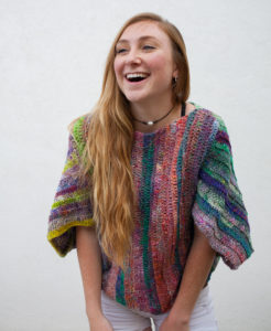 Lady wearing multicolored crochet top, bifrost crochet top