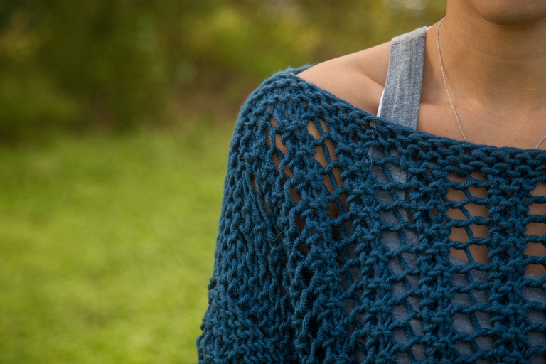 Lady wearing blue knit sweater, knit pattern