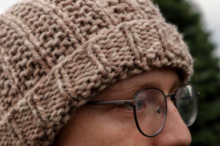 Close up image of the knit hat being worn by man with glasses, Carten Knit Hat Pattern