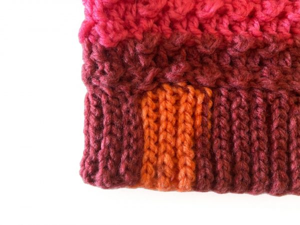 Clancy Orange and Red Crochet Beanie on a head form