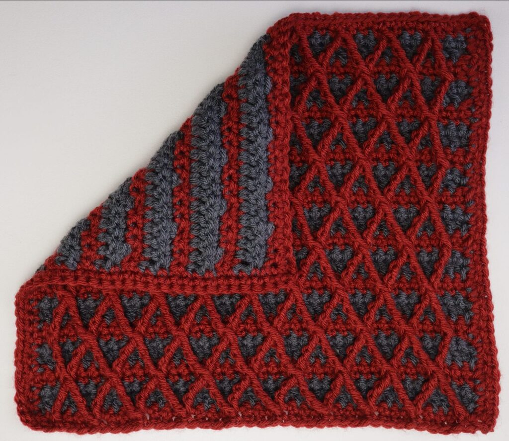 Rusted Fence stash busting sampler square with tulip hook