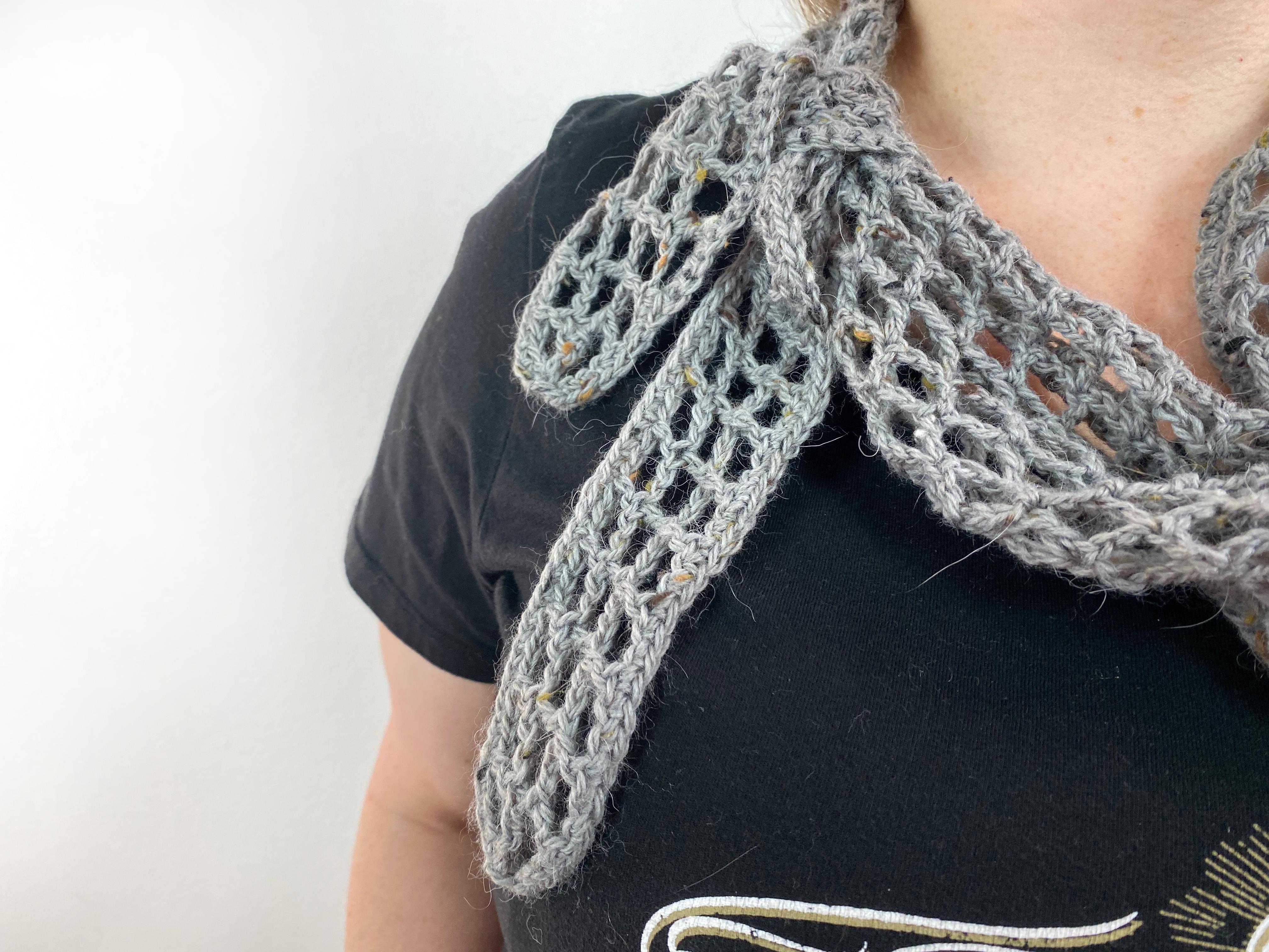 Lady wearing grey tibbs crochet kerchief
